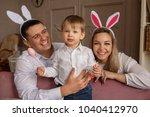 happy easter. young joyful... | Shutterstock . vector #1040412970