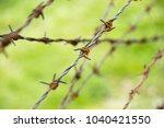 barbed wire fence | Shutterstock . vector #1040421550