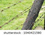 barbed wire fence | Shutterstock . vector #1040421580