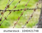 barbed wire fence | Shutterstock . vector #1040421748
