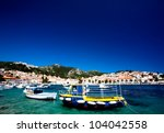 yellow fishing boat anchered in ... | Shutterstock . vector #104042558