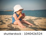 happy child on sea with... | Shutterstock . vector #1040426524
