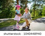 father teaching his daughter to ... | Shutterstock . vector #1040448940