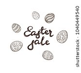 black lettering easter sale and ... | Shutterstock . vector #1040449540