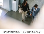 business people arriving at... | Shutterstock . vector #1040453719