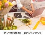 female florist receiving an... | Shutterstock . vector #1040464906