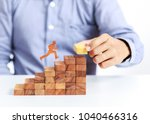 businessman climb up on stair... | Shutterstock . vector #1040466316