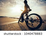 cyclist looking at the sunrise... | Shutterstock . vector #1040478883