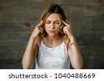 tired beautiful woman suffering ...   Shutterstock . vector #1040488669
