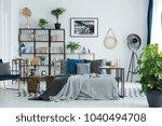 grey bedsheets on bed in... | Shutterstock . vector #1040494708
