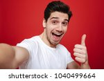 portrait of a happy young man... | Shutterstock . vector #1040499664