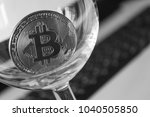 bitcoin in a glass on laptop... | Shutterstock . vector #1040505850