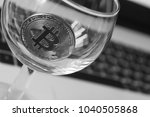 bitcoin in a glass on laptop... | Shutterstock . vector #1040505868