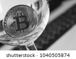 bitcoin in a glass on laptop... | Shutterstock . vector #1040505874