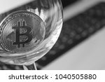 bitcoin in a glass on laptop... | Shutterstock . vector #1040505880
