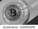 bitcoin in a glass on laptop... | Shutterstock . vector #1040505898
