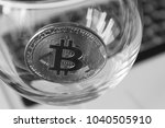 bitcoin in a glass on laptop... | Shutterstock . vector #1040505910