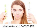 woman holding  choosing between ...   Shutterstock . vector #1040505970