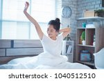 asian women she is in bed and... | Shutterstock . vector #1040512510