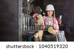 young woman as metalworker in... | Shutterstock . vector #1040519320