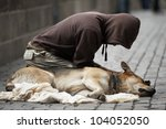 Beggar With Dog On The Street...