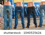 dolls with blue jeans on the... | Shutterstock . vector #1040525626