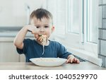 the child in the kitchen at the ... | Shutterstock . vector #1040529970