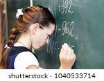 a schoolgirl at the blackboard... | Shutterstock . vector #1040533714