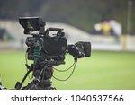 tv camera at the stadium ... | Shutterstock . vector #1040537566