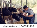 farmers are recording details... | Shutterstock . vector #1040541433