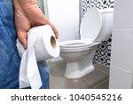 hand holding toilet paper... | Shutterstock . vector #1040545216