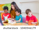 asian female teacher teaching... | Shutterstock . vector #1040546179
