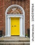 yellow classic door in dublin ...   Shutterstock . vector #1040598964