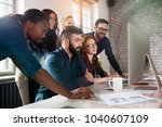 group of young designers... | Shutterstock . vector #1040607109