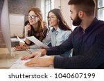 group of young designers... | Shutterstock . vector #1040607199
