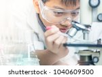 scientist with equipment and... | Shutterstock . vector #1040609500