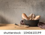 male baker prepares bread. male ...   Shutterstock . vector #1040610199