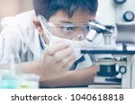 young asian scientist are... | Shutterstock . vector #1040618818