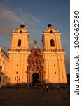 The main Cathedral in Lima, Peru, built in 1540, at dusk with golden light and shadows - stock photo