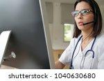 medical secretary typing report ... | Shutterstock . vector #1040630680