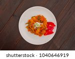 potato goulash with tofu on a... | Shutterstock . vector #1040646919