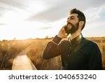 content adult man with beard in ... | Shutterstock . vector #1040653240