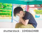 stress of asian boys in the... | Shutterstock . vector #1040663488