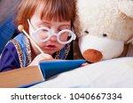 cute little child girl reading...   Shutterstock . vector #1040667334