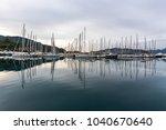 moored yachts in a quiet bay in ... | Shutterstock . vector #1040670640
