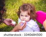 child with an easter egg in the ... | Shutterstock . vector #1040684500