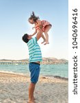 father playing with his... | Shutterstock . vector #1040696416