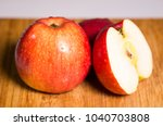 three red apples with shadow on ... | Shutterstock . vector #1040703808