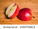 red sliced apple on a wooden... | Shutterstock . vector #1040703814