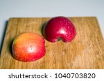 red sliced apple on a wooden... | Shutterstock . vector #1040703820